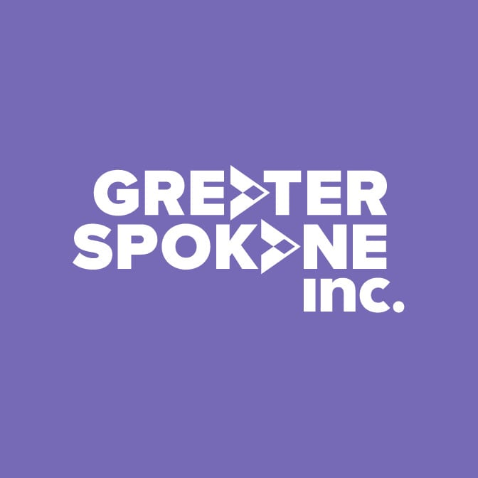 Greater Spokane Incorporated logo on purple background